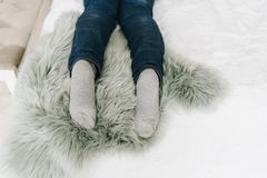 Woman`s feet as she is lying on bed stock image