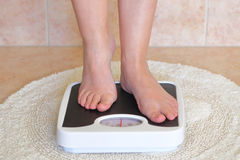 Woman's feet on bathroom scale Royalty Free Stock Photos