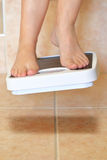 Woman's feet and bathroom scale Royalty Free Stock Photography