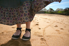 Woman's feet on a beach Royalty Free Stock Photos