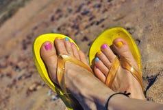 Woman s feet on the beach Stock Photo