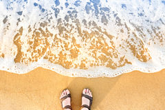 Free Woman`s Feet In Sandals On A Beach Sand Royalty Free Stock Image - 93606146