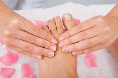Woman's feet receiving foot massage Royalty Free Stock Photos