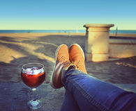 Woman's  Feet relaxing on the beach Royalty Free Stock Photos