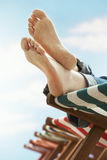 Woman's Feet Relaxing On Deckchair Royalty Free Stock Image