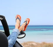 Woman's feet relaxing by sea Royalty Free Stock Photo