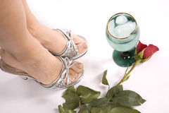 Woman's feet rose and glass Royalty Free Stock Photography