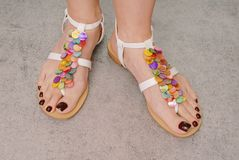 Womans feet are on  sandals. Stock Photos