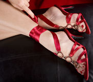 Woman's feet in sexy shoes. Woman's feet in sexy red shoes Stock Photo
