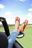 Woman's feet starring out of car window Royalty Free Stock Photography