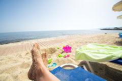 Woman's feet on a sunbed. Summer vacation concept Stock Image