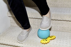 Woman's feet tripping on a Child's Toys Stock Image
