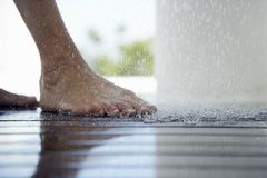 Woman's Feet Under Shower Royalty Free Stock Photo
