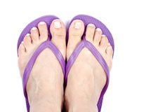 Woman's Feet Wearing Purple Flop Flops Stock Images