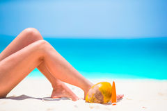 Woman's feet on the white sand beach in shallow water Royalty Free Stock Photography