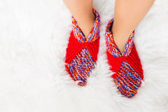 Woman's feet in woolen socks Royalty Free Stock Image