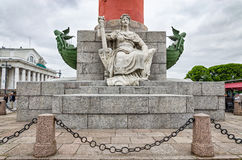 A woman's figure sitting at the foot of the rostrum column on the Spit of Vasilievsky Island. Stock Photo