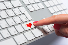 Woman's finger pressing keyboard button Royalty Free Stock Image