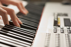 Woman's Fingers on Digital Piano Keys Royalty Free Stock Photos