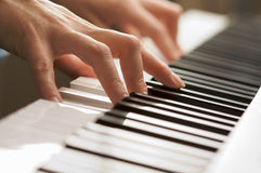 Woman's Fingers on Digital Piano Keys Stock Photos