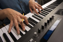 Woman's Fingers on Digital Piano Keys Stock Photography