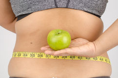 Woman's fingers measuring her belly fat Royalty Free Stock Image