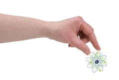 Woman's fingers pinching nucleus of an atom. With fingers over a white background royalty free stock photography