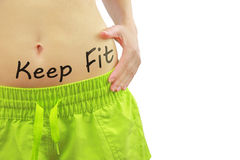 Woman's fit belly with Keep Fit text Royalty Free Stock Photography