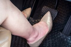 A woman`s foot on the brake pedal of  car. A woman`s foot on the brake pedal of a car Royalty Free Stock Photography