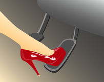 A womans foot in a high heeled red shoe Stock Images
