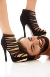 Woman's foot on man's face. Woman's foot in high heel on man's face, dominating him stock image