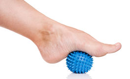 Woman's foot with massage ball Royalty Free Stock Image