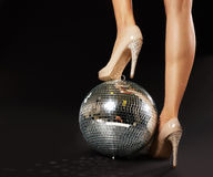 Woman's Foot Over Disco Ball Stock Photography