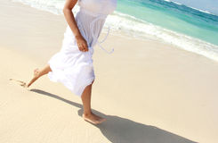 Woman's foot while running on the beach Royalty Free Stock Photos