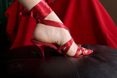 Woman's foot in sexy shoe. A woman's foot in a sexy red high-heeled shoe Stock Image