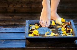 Woman's foot into water Stock Photo