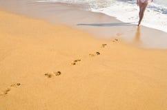 Woman's footprints Royalty Free Stock Photo