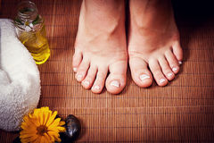 Woman's french manicure and pedicure Royalty Free Stock Image