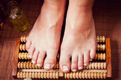 Woman's french manicure and pedicure. Beautiful female feet and hands Stock Photos