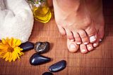Woman's french manicure and pedicure Royalty Free Stock Images