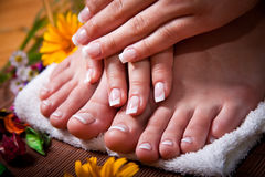 Woman's french manicure and pedicure royalty free stock photos