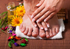 Woman's french manicure and pedicure Stock Photography
