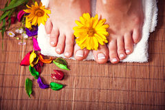 Woman's french manicure and pedicure. Beautiful female feet and hands Royalty Free Stock Images