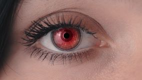 Woman`s futuristic eye with biotechnology embedded in the eye. Eye scanning with surveillance system