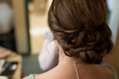 Woman's hairdo Special Event. Female with Hairdo up for special event such as wedding or graduation Royalty Free Stock Photography