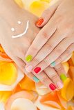 Woman's Hand Above Flower Petals. Close-up Of Woman's Hand With Moisturizer Above Flower Petals Stock Photography