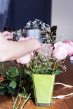 Woman's hand arranging bouquet of pink  roses -close up Royalty Free Stock Photo