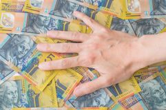 Woman's hand on Australian Dollar Royalty Free Stock Images