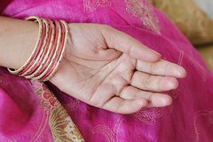 A woman's hand with bangles Stock Photography