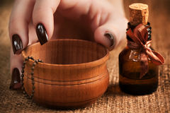 Woman's hand with a bottle of essential oil Stock Photos